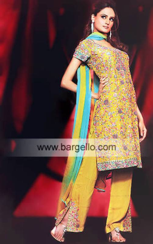 Gold heavily embellished shalwar kameez trouser suit with dupatta