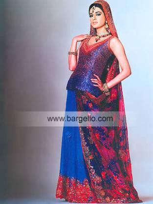 Medium blue haute couture designer wedding gown and veil